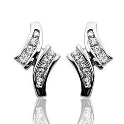 Upeita timantti nappikorvakorut 14 karaatin valkokultaa kanssa timanttia